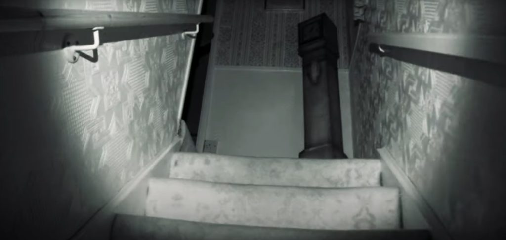 A still from the ParaPod movie. Night vision footage, going up the stairs in a haunted house.